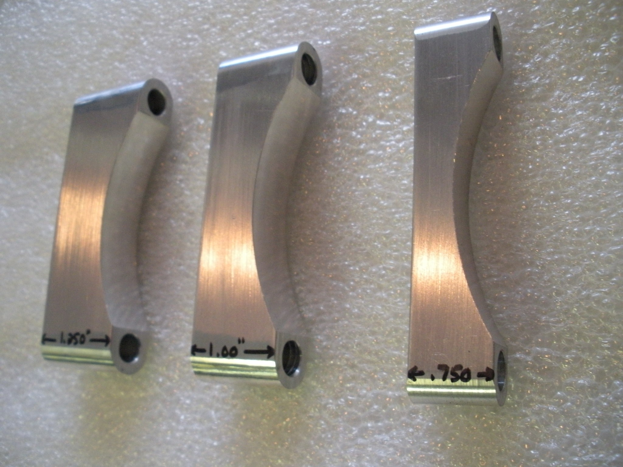 Assorted width raw fender spacers.